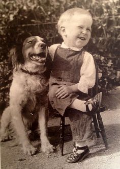 A boy and his dog. Pure happiness…the way he has his foot over his knee he probably got from his pops!