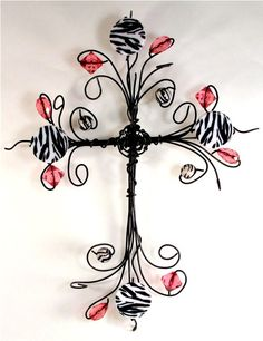 This cross features swirls of black wire with acrylic zebra striped and hot pink beads intertwined within the wire. It measures about 12 inches inches wide. Each cross has a small hook on the back for hanging or can stand by flaring out the bottom. Wire Crafts, Jewelry Crafts, Wire Crosses, Mosaic Crosses, Cross Art, Cross Crafts, Beaded Cross, Wire Art, Beads And Wire