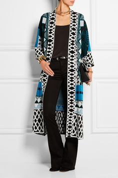 Temperley LondonTemperley London's 'Gayla' coat is knitted with a bold black, white, jade and azure intarsia. It's cut for a loose fit and finished with split sides for elegant movement. Seen on the runway styled over a printed dress, this statement piece also works well with all-black outfits.