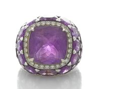 An amethyst and diamond ring central square-shaped cushion-cut amethyst measuring approximately: 15.1 x 15.0 x 9.7mm; mounted in eighteen karat gold.