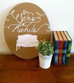 Attractive book/plant display.