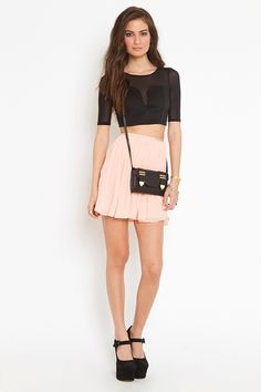 nasty gal. black crop top with pink skirt. perfect combo.