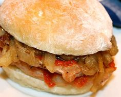 Bifana is a traditional Portuguese sandwich. It is prepared with papo seco (a Portuguese bread roll) and very thin marinated pork cutlets, on which the cooking juices are drizzled Sandwiches, Pork Sandwich, Sandwich Recipes, Portuguese Desserts, Portuguese Recipes, Portuguese Food, Portuguese Sweet Bread, Learn Portuguese, Portuguese Culture