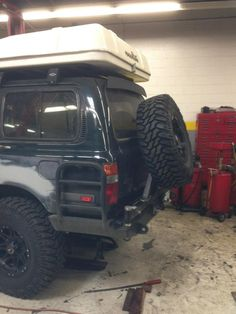 """We also had to modify the rear tire holder on this Toyota Land Cruiser FJ80 to fit the new 37"""" spare tire"""