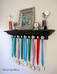 Attach decorative knobs to a ledge shelf for trophy and medal awards display - DIY Deko Diy Trophy, Trophy Shelf, Trophy Display, Award Display, Display Medals, Medal Displays, Hanging Medals, Trophy Stand, Football Bedroom