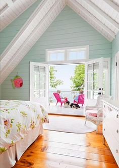 Room with a view  Transom-topped French doors in the master bedroom open up to a private deck outfitted with hot-pink Adirondack chairs in this Door County, Wisconsin, home. #Design http://www.midwestliving.com/homes/room-decorating/beautiful-bedroom-designs/