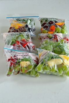 Easy to Make Smoothie Packs combine fruit, spinach, flax seeds, and yogurt in a freezer baggie that makes a delicious smoothie when combined with juice!