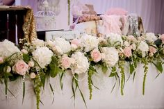 Blush and ivory draping luxury long and low top table flowers with pearl accents hydrangea and sweet avalanche roses. Flowers by Fleur Couture Image by Casablanca Photography Venue - The Biscuit Factory / Biscuit Room Belle Bridal Wedding Wondershow Altar Flowers, Wedding Table Flowers, Bridal Flowers, Wedding Reception Decorations, Floral Wedding, Table Flower Arrangements, Floral Centerpieces, Wedding Centerpieces, Bridal Table