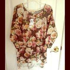 Love by Design Floral Sweater Tunic Floral Multi Beautiful stretchy and soft sweater. Could fit 2xl. Would also look amazing win leggins! Design Tops Tunics