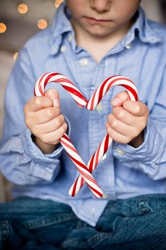 Christmas card photo - 2013? (smj)  This would be cute for the boys to do!   candy cane heart...cute idea for christmas card