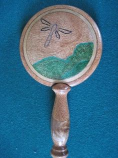 Dragonflies in lacewood.  Inage contains stone inlays including malachite, granite, and sodalite.