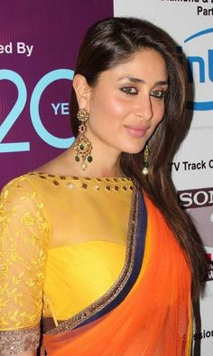 Kareena Kapoor in orange net saree with navy blue border paired with yellow high neck blouse with self thread work by Manish Malhotra