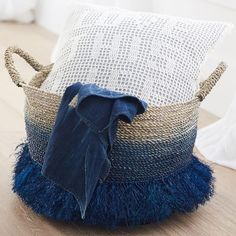 Ombre Fringe Basket This Ombre Fringe Basket keeps your space organized and your style on point. Made from seagrass and sisal, it lends a natural, bohemian feel to your space that's complemented by a rich blue color scheme. It's perfect for storing must-haves like yoga mats, blankets and pillows.