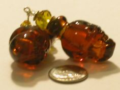 Wholesale Rare Findings*~1 Pc. Murano Glass AMBER Skull perfume/oil Bottle*fillable charm pendant Bottle*~ All brand New,Total of 1 Pc Vintage style clear Amber brown real murano Skull head glass bottle with silver plated bead cork*~This is a absolutely adorable and beautiful quality*This would make a great gift or you can resell them or keep for yourself...They work perfectly for filling them with all kinds of *perfume,oils,Crystals,gemstones,liquids,beads,charms,beach sand,beach glass,...