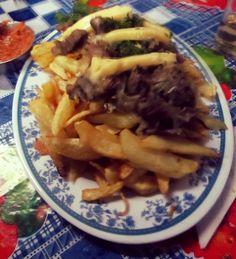 Chorrillana, typical Chilean dish.