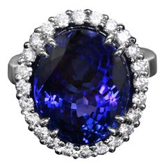 This beautiful 18k white gold ring features a stunning 14 carat Tanzanite center stone which is surrounded by 24 white round cut diamonds with a total carat weight of apx. 1.75 carats. 21st century