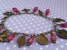 Frosted Pink and Antique Bronze Charm Bracelet - Folksy Crochet Elephant, Pink Elephant, Bronze Jewelry, Frost, Glass Beads, Feather, Dangles, Charmed, Antiques