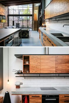 This industrial modern kitchen features a concrete countertop, wood cabinets and black hardware. Small holes have been used to create an artistic pattern on the light wood upper kitchen cabinets.