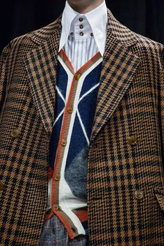 Triple buttoned shirt and argyle cardigan backstage at Vivienne Westwood AW15 Milan. See more here: http://www.dazeddigital.com/fashion/article/23240/1/vivienne-westwood-aw15-livestream