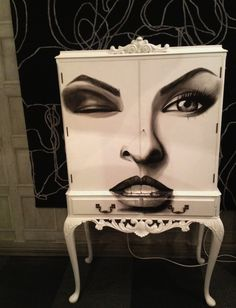 The latest cocktail cabinet with Linda Evangelista painted on the front! available in Jimmie Martin's showroom.