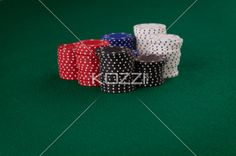 pile of poker chips - A pile of poker chips can be interpreted as cash or money.