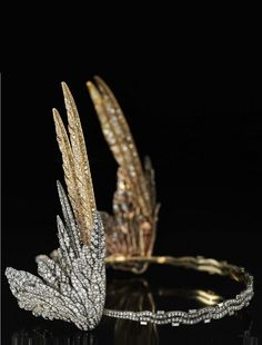 Cartier - An Art Deco silver, gold and diamond Valkyrie tiara, circa 1935. The tiara was commissioned by the late Mary Crewe-Milnes, Duchess of Roxburghe in 1935 - the year of her marriage to the 9th Duke of Roxburghe. Inspired by the winged helmets worn by the heroines of Wagner's opera cycle Der Ring des Nibelungen, the tiara is the last of its type ever made by Cartier.