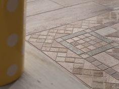 Dettaglio di decoro.Collezione Metalwood per pavimenti in gres porcellanato con effetto legno.