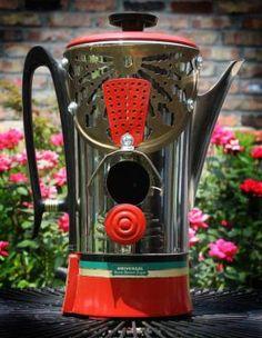 Recycled coffee pot birdhouse