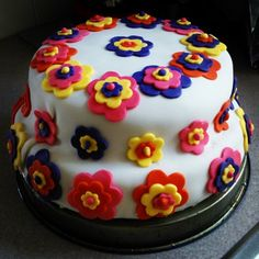 officially my #secondtime working with #fondant! #white with #pink, #orange, #purple, and #yellow #flowers!!!! #yummy #love
