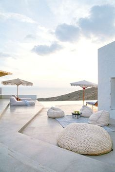 WHITE BY DESIGN | NgLp Designs shares... Beach House in Greece for outdoor décor ideas with relaxed summer styling | water views | all white décor palette | home décor | architecture | bean bag chairs | macrame style | patio lounge furniture /// #homedecor #whitedecor #patio Outdoor Spaces, Outdoor Living, Outdoor Decor, Future House, My House, Villas, Myconos, Balcony Design, House Goals