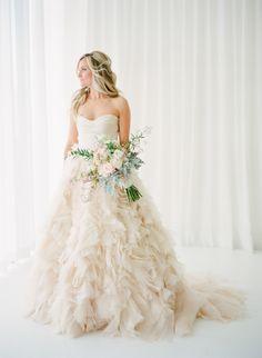 Strapless statement elegant ruffled wedding gown: http://www.stylemepretty.com/2016/10/01/blush-pink-wedding-dresses/ Photography: KT Merry - https://www.ktmerry.com/