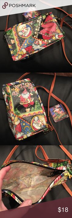 """Mary Engelbreit Santa Christmas crossbody NWT Never used, still has the tag on it. Detachable strap, made of oil cloth, zip top closure, made in the USA by Nordic House Designs. Non smoking home. 8 1/4""""x2""""x5 1/2"""" with a 22"""" strap drop Mary Engelbreit Bags Crossbody Bags"""