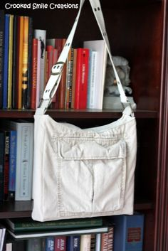 Awesome idea. Messenger bag made from used cargo shorts, a t-shirt, and a belt.