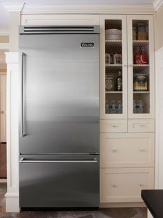 I love this fridge, but it is great next to cabinets with chicken wire inserts. It is just the right mix of modern with country.