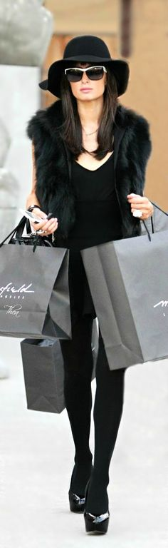 I have to do a lot of shopping for Dressing For My Life. But its sooooo fun. Patti Montgomery. Black fur vest, black top, skirt, black tights, and great sunglasses.