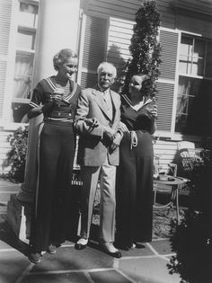 Doris Duke, wearing sailor suit outfit, with her father-in-law E. T. Stotesbury.