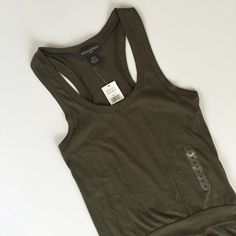 Banana Republic Tank Army green colored tank from Banana Republic, NWT. It is adorable, with a little band that gives it a peplum/tunic style. Love with skinnys and booties! size small   🚫No trades 🚫No 🅿️aypal 🚫No Merc ✅Posh Rules ✅Use Offer Button ✅Bundle for 15% off 💕 📷Instagram @BeThriftyChic Banana Republic Tops Tank Tops