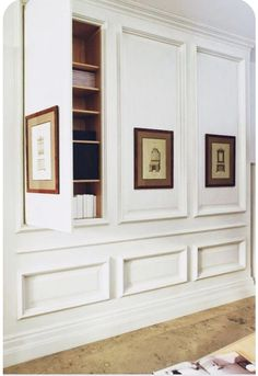 White paneling detail with clever hidden storage. White paneling detail with clever hidden storage. Image Size: 612 x 815 Source Hallway Storage, Cupboard Storage, Wall Storage, Hidden Storage, Secret Storage, Storage Spaces, Hidden Shelf, Bookshelf Storage, Office Storage