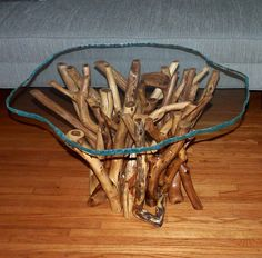 Elegant glass top tree tables from a rustic stump. Beyond rustic furniture in it's elegance. Furniture art by Mike Just.