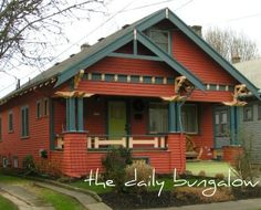 A Story, Front Gable Bungalow With A Rich Red Color Scheme And Just A Touch  Of Chartreuse. The Bungalow