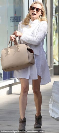 Oversized accessories: The Host actress brought along a large tote and wore tortoise sunglasses that shielded her face