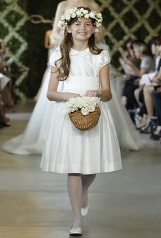 Brides.com: . Knee-length silk A-line flower girl dress with short sleeves and a Peter Pan collar, Oscar de la Renta  See more Oscar de la Renta flower girl dresses in our gallery.