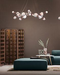 ATOMIC ROUND SUSPENSION LAMP | A contemporary descendant of retro sphere lighting, Atomic suspension lamp is a spot-on interpretation of the atomic age design | www.bocadolobo.com #livingroomdecor #homedesign