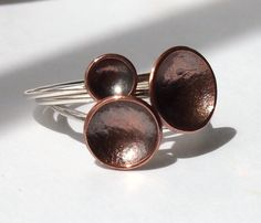 Three Silver and Copper Grass Seed Cup Stacking Rings £45.00