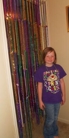 What I did with some of the leftover Mardi Gras beads...easy beaded curtain for my daughter's room....