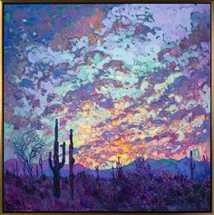 Dusk in the desert, with the silhouette of Saguaro cactus.