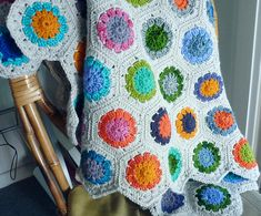 How cool is this?  Looks like a traditional hexagonal quilt, but it's actually crochet!  I'm totally making this!