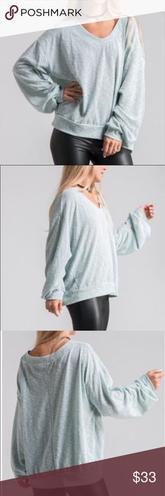 Two tone slouchy sweatshirt Aqua blue two tone knit slouchy fit sweatshirt. Slub knit, rounded v neck, full length sleeves with double pleat style in seam. Banded hem and cuffs. Polyester, rayon, spandex blend. Made in USA. S-2/4, M-6/8, L-10/12. Tops