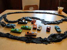 Black playdough for roads.