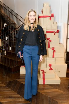 Olivia Palermo celebrates The Tale Of ThomasBurberry at the New York SoHo store. Olivia wears a wool silk military cape jacket with brass buttons.